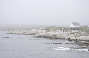 house on foggy coast