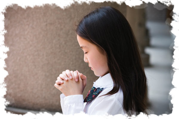 Asian girl praying