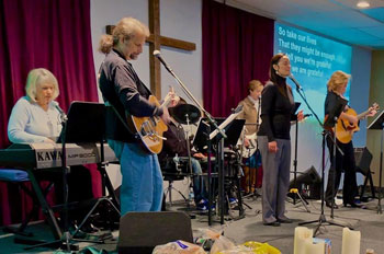 John Kohlenberger leading worship