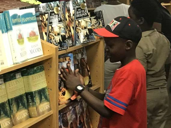 Child at the bookstore on Logos Hope