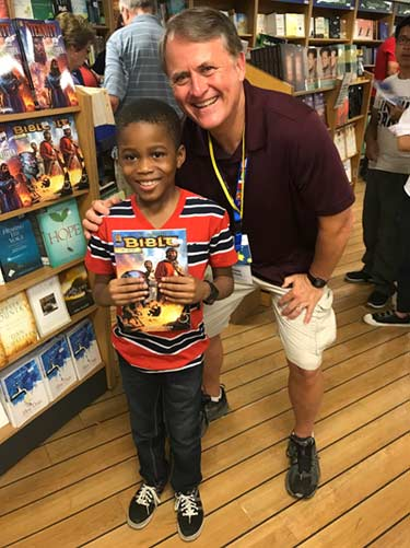 Randy with a child in the bookstore