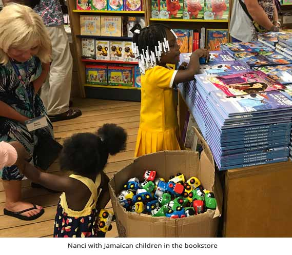 Nanci with Jamaican children in the bookstore
