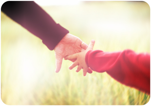 Parent's hand holding child's hand / A Spiritual Partnership