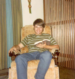 Randy reading as a teenager