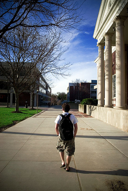 Student walking on college campus / What about student loans? (photo credit: justingaynor via photopin cc)