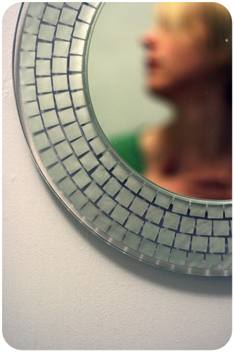 Woman's face in mirror